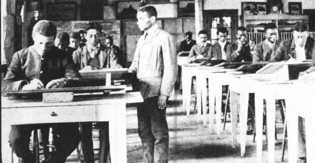 Students and faculty in a Tuskegee drafting class