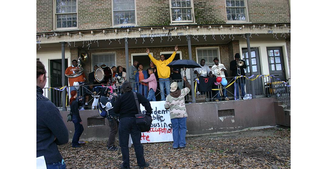 Residents of the CJ Peete/Magnolia projects protest prior to demolition